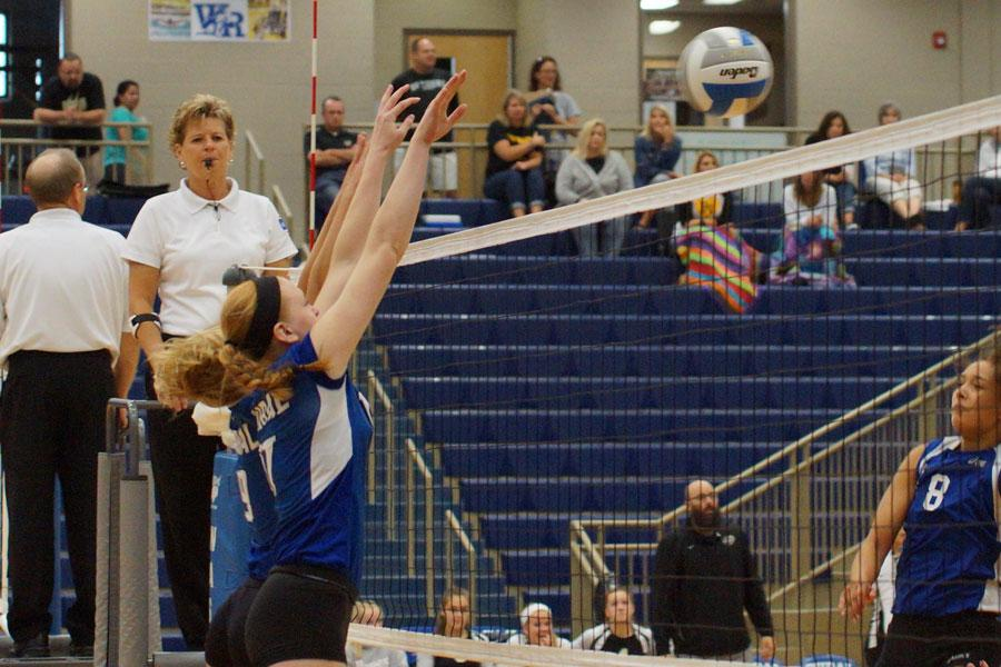 Sophomores Shelby Ebert and Sydney Houser go up for a block during the WRHS Invitational on Sept. 24.