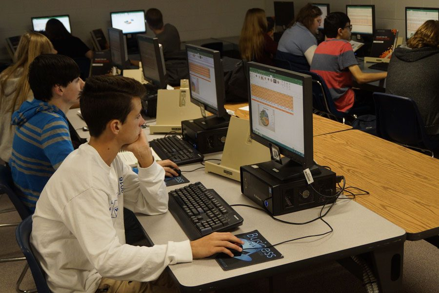 Freshman Caden Merrick works on a computer during third hour Computer Applications. The One-to-One Initiative would supply a laptop to each student.
