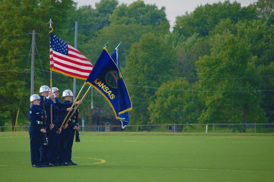 The JROTC color guard present the colors during the national anthem before the boys soccer game on Sept. 20.