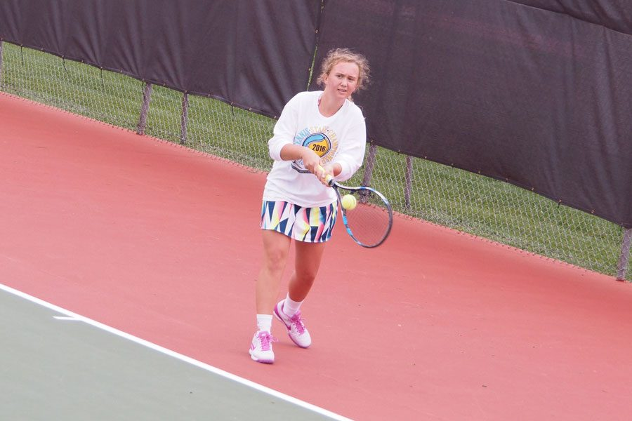 Freshman Lauren Pryor prepares to hit a backhand during the State singles tournament on Oct. 14.