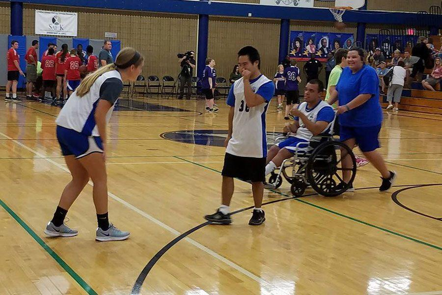 Camber English, Paul Sharp, Ramon King and Sydney Kerstiens participate in the first Unified Sports basketball tournament on Oct. 16.