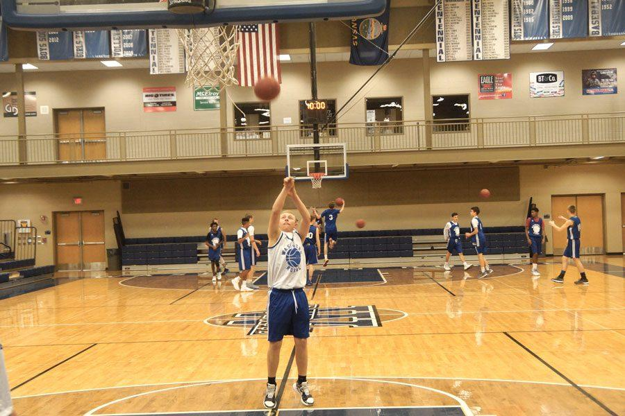 Senior+Zach+Ebert+shoots+a+free+throw+during+the+inter-squad+scrimmage+on+Nov.+28.
