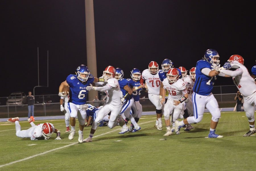 Senior Hunter Browning shakes off a tackle during the team's 27-15 victory over Dodge City on Oct. 28.