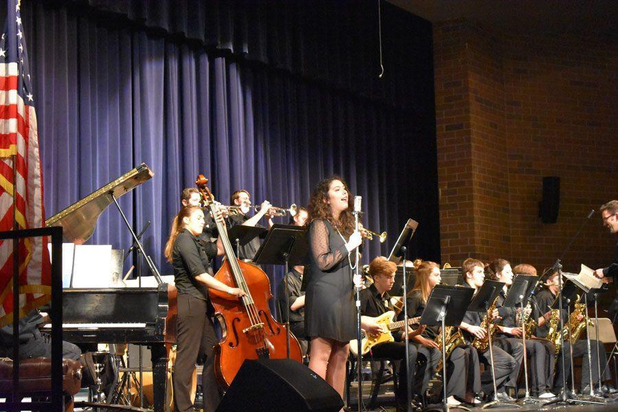 Junior Faith Maddox sings during the fall jazz concert on Nov. 15.