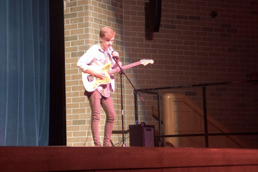 Junior Paul Frederickson performs a song called