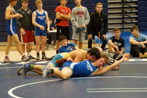 Wrestling tops second ranked team in state