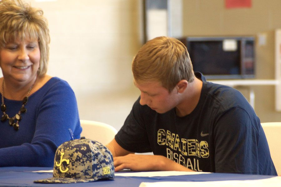 Senior Zach Ebert signs his National Letter of Intent to play baseball at Johnson County Community College on Nov. 9.