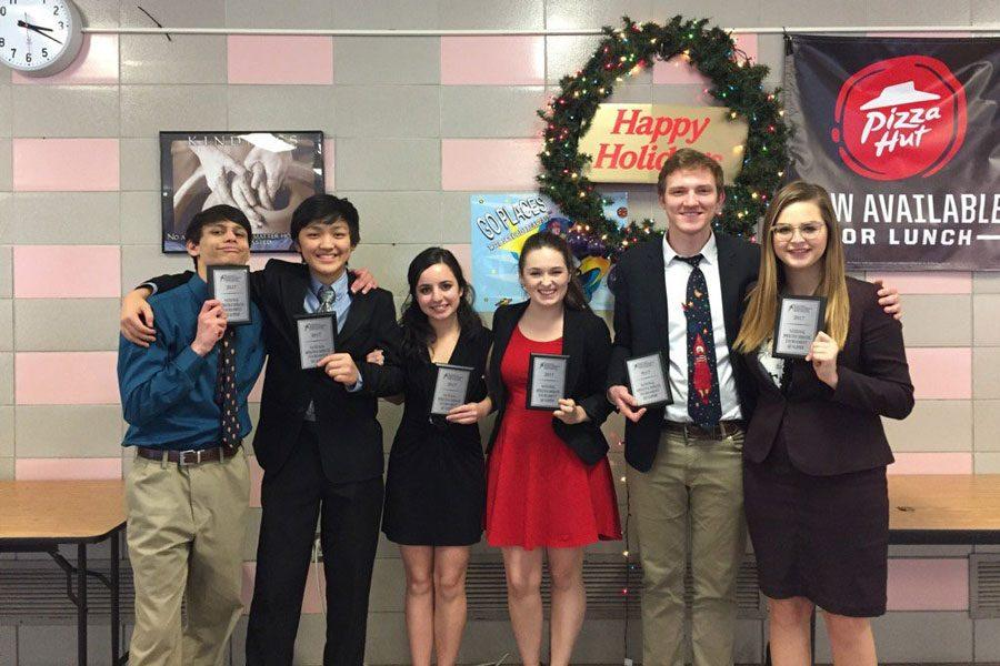 Sophomores Harun Khan and Jimin Park and seniors Serena Peter, Hailey Robertson, Ethan Eitutis and Peyton Emler qualified to the National Debate Tournament in June.