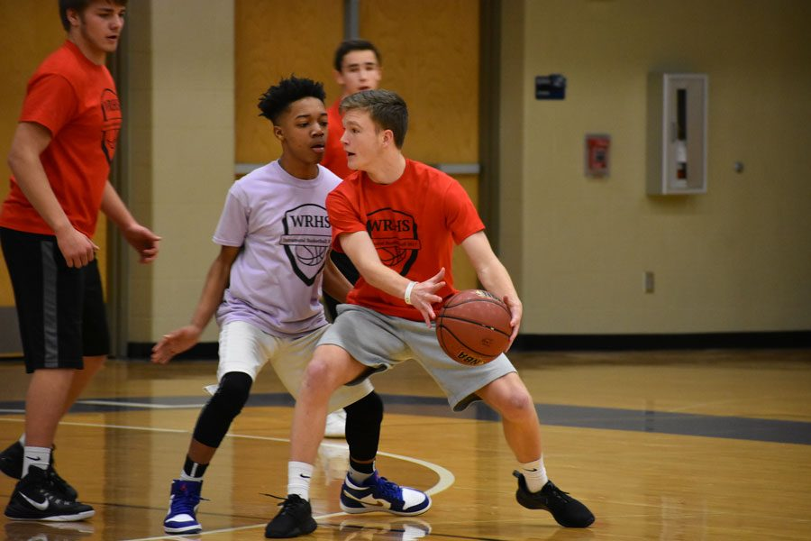 Junior Oshae Johnson guards sophomore Zach Pelton as he looks for a teammate to pass it to during an intramural basketball game on Jan. 19.