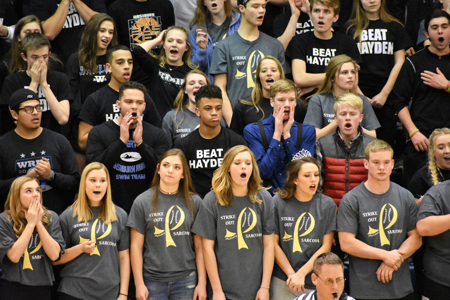 The student section cheers on the boys basketball team during their 69-56 loss to Hayden on Feb. 10.