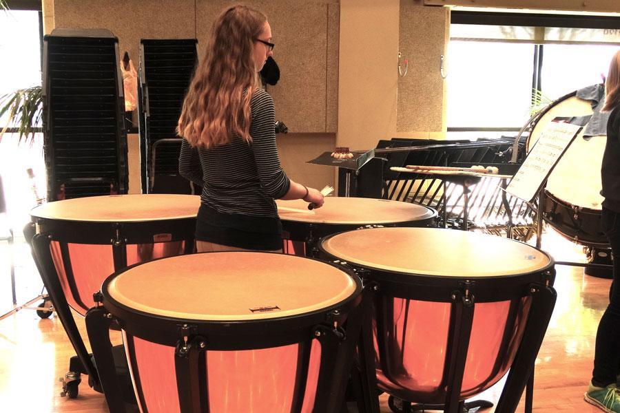 Junior KJ Davis plays the marimba during rehearsal on March 8.