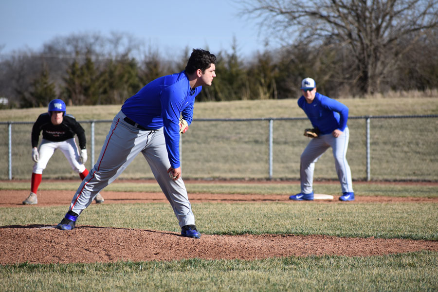 Sophomore Payton Smith prepares to throw a pitch at practice on March 16.